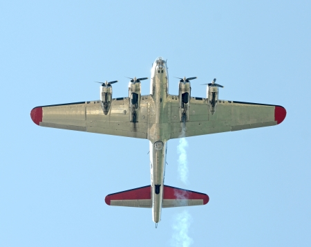 aircraft bomber: Heavy World War II era bomber flying overhead