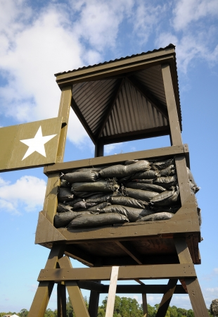 outpost: Observation tower in military camp in green camouflage colors