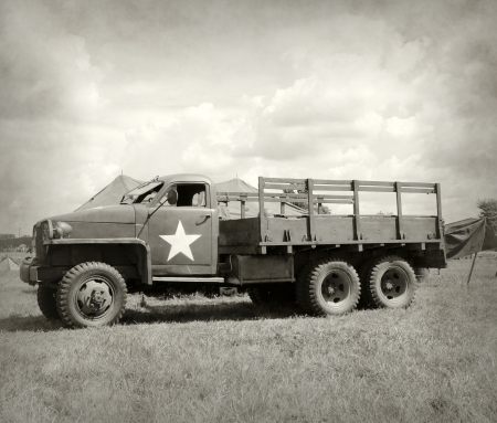 world war two: World War II era military truck at a camp Editorial