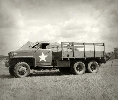 world war ii: World War II era military truck at a camp Editorial