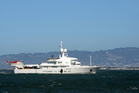 super yacht: Luxury yacht with helicopter on the back side view