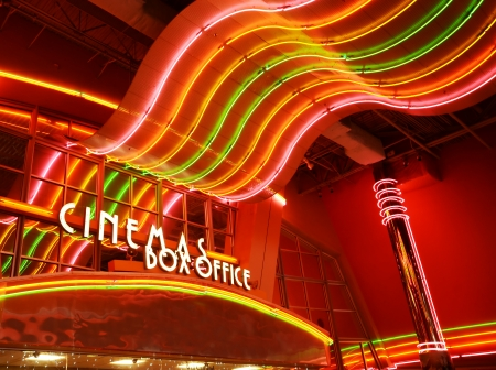 showbusiness: Retro glowing neon lights at movie theater box office