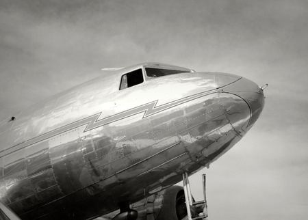 Old propeller airplane in black and white photo