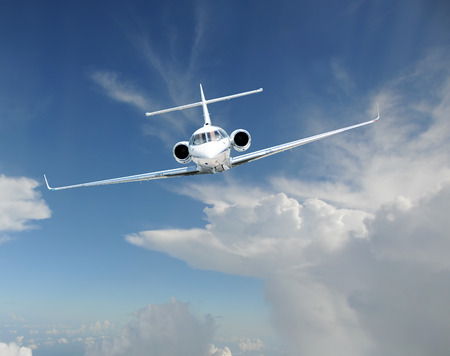 Corporate jet airplane at high altitude front view