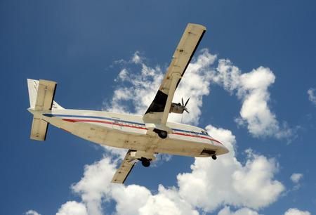 turboprop: Modern turboprop airplane transporting cargo closeup view