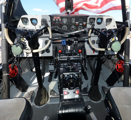 Interior cockpit view of old propeller airplane