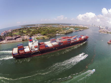 Heavy container ship entering Port of Miami aerial view
