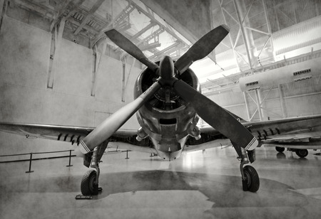 world war two: World War II era fighter plane in a hangar Editorial