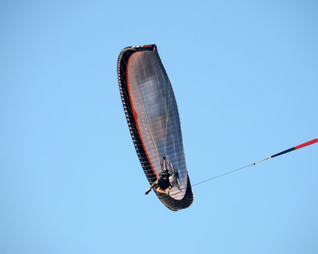 paraglider: Paraglider extreme sports flying overhead Stock Photo