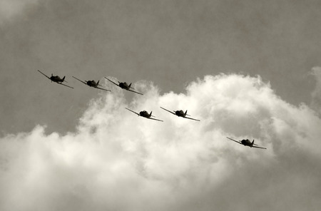 world war two: Retro propeller airplane flying in formation
