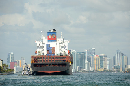 Heavy containet cargo ship enters the port of Miami, Florida photo