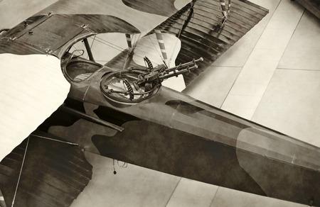 world war: World War I era military airplane stained black and white