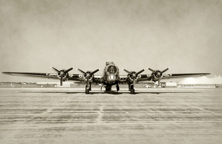 World War II era heavy bomber front view stained old photo