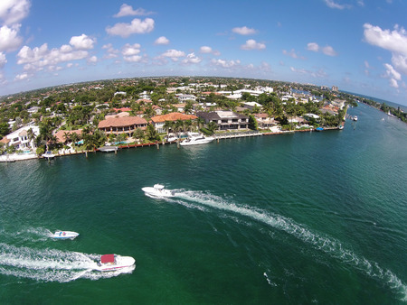 Weekend boating on the waterways of Boca Raton, Florida, birds eye view