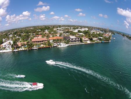 birds eye: Weekend boating on the waterways of Boca Raton, Florida, birds eye view