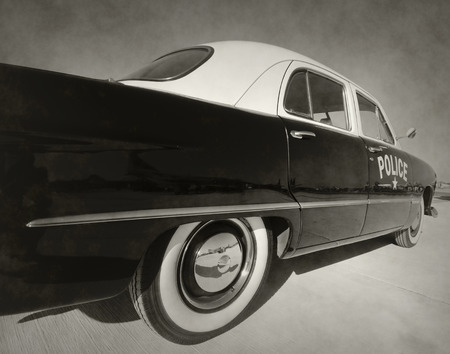 patrol officer: Retro police car in stained black and white color