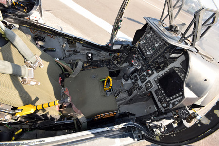 Modern fighter jet cockpit and pilot seat top view