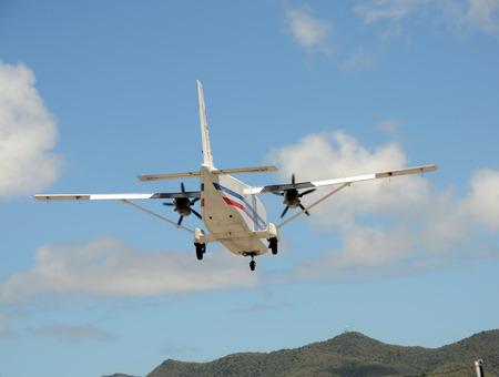 turboprop: Turboprop airplane landing rear view