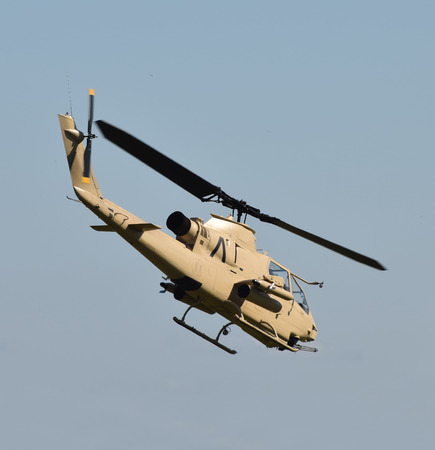 Vietnam War era military helicopter departing on a mission
