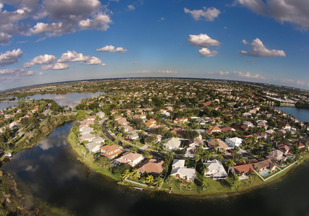 residential home: Suburban waterfront homes in Florida aerial view Stock Photo