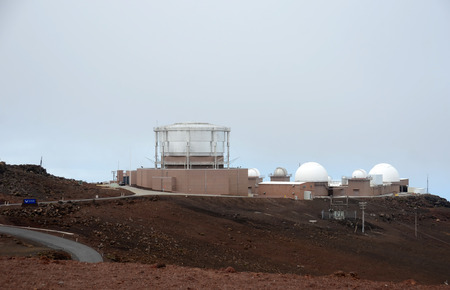 outpost: Honolulu, USA - March 24, 2013: US AIr Force radar tracking station placed on high alert in the escalating tension with North Korea. Facility is located on top of the Haleakala volcano, Hawaii.