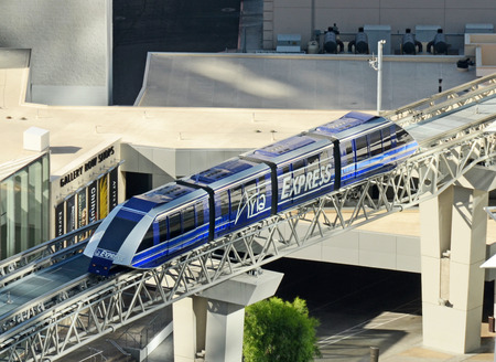 increasingly: Las Vegas, USA - June 21, 2012: Passengers move along the Las Vegas strip by way of monorail. It is an increasingly popular means of transportation along the strip