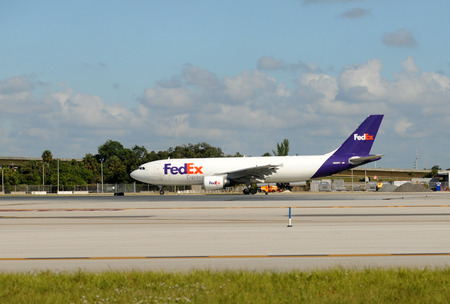 jetliner: Fort Lauderdale, USA - Federal Express cargo jet airplane departs from Fort Lauderdale, Florida on October 30, 2009 to its home base in Memphis, TN