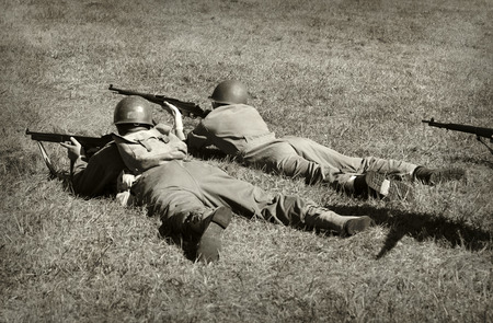 frontline: Two World War 2 era soldiers on the ground shooting
