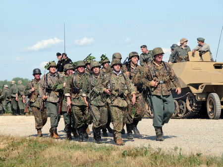 Bellevue, Michigan - August 9, 2008: History enthusiasts recreate a World War II era battle. The popular reenactment event is part of the annual Thunder Over Michigan Airshow.