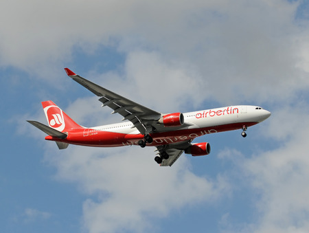 jetliner: Miami, Florida - November 21, 2010: Air Berlin jetliner landing at Miami International Airport. Air Berlin continues to expand its services from Germany to US destinations
