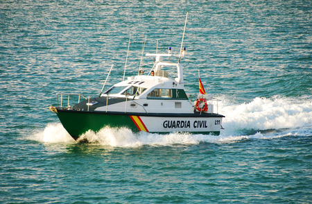 drug trafficking: Barcelona, Spain - October 21, 2007: Spain Civil Guard (Guardia Civil) patrols the port of Barcelona. Due to the large volume fo trade and passengers this location is a center of drug trafficking
