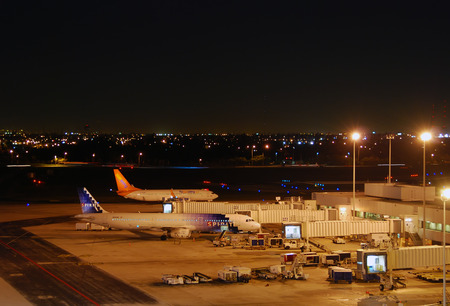 Fort Lauderdale, Florida - February 9, 2007: Night view of the Fort Lauderdale Hollywood International Airport ( FLLKFLL) in Fort Lauderdale, Florida. The airport handles a lot of tourist traffic to and from South Florida.