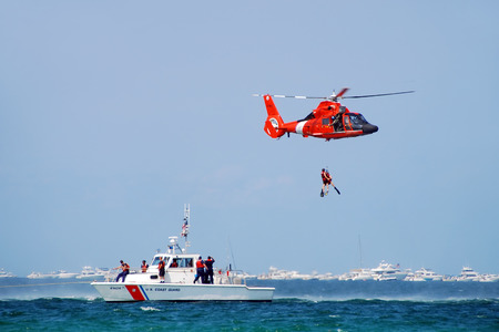 Fort Lauderdale, Florida - May 5, 2007: US Coast Guard crews conduct rescue operation at sea. The safety  training event is part of the Air and Sea Show 2007.