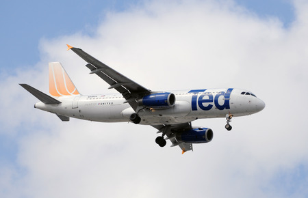 ted: Miami, Florida - February 18, 2009: Uniteds low cost subsidiary called Ted flying and Airbus A-320 jet. Ted was eventually discountinued as a brand