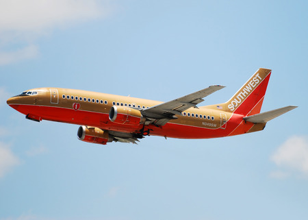 exclusively: Fort Lauderdale, Florida - June 3, 2007: Southwest Airlines passenger jet departing Fort Lauderdale Hollywood International Airport. Southwest operated a fleet of Boeing 737 jets exclusively Editorial