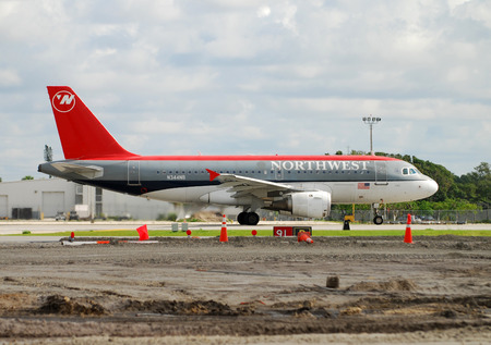 livery: Fort lauderdale, Florida - June 9, 2007: Northwest Airlines Airbus A-319 jet departing from Fort lauderdale Hollywood International Airport. This traditional NWA livery has now been replaced with Delta airlines livery after the merger of the two airlines Editorial