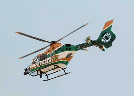 increasingly: Fort Lauderdale, USA - October 2, 2010: Local Sheriff Department helicopter departs on patrol. The police is increasingly relying on new technology to fight crime