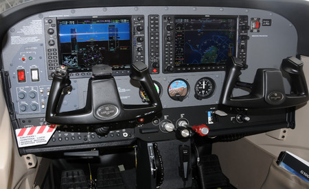 avionics: Miami, USA - March 7, 2009: State of the art Garmin G1000 avionics suite mounted on a light private propeller airplane. Manufacturers are making these options affordable to the private pilot. Editorial
