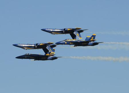skillful: Houston, USA - November 1, 2009: US Navys Blue Angels aerobatic team demonstrate their piloting skills. The Blue Angels attaract the Navys best pilots