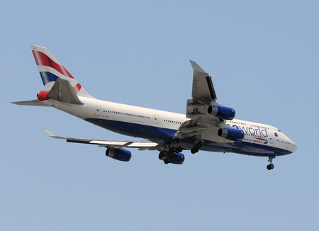 vacationers: Miami, USA - May 14, 2011: British Airways Boeing 747 jumbo jet landing at Miami International Airport. Miami is a popular tourist destination for British vacationers Editorial