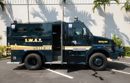uses: Fort Lauderdale, USA - October 2, 2010: Broward County, Florida Sheriff Department prepares heavily armored vehicle for service. The police department uses a variety of specialized equipment for its daily operations