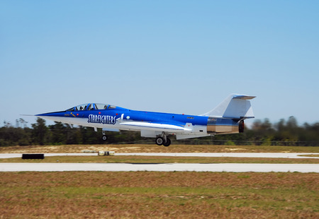 cold war: Titusville, USA - March 17, 2007: Cold War era Lockheed F-104 Starfighter visiting Space Coast Airport in Titusville, Florida. These supersonic interecptor jets were used in the 60s and 70s. Only a handful remain flying today.