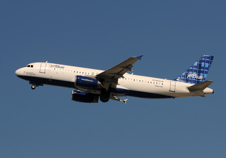 jetblue: Fort Lauderdale, USA - January 29, 2011: Jetblue Airbus A-320 jet taking off from Hollywood Fort Lauderdale International Airport. jerblue is one of the fastesr growing discount airlines in the USA