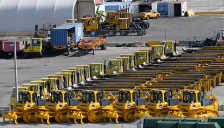 machinery: Miami, USA - July 18, 2008: Tractors and other construction machinery awaiting export from the port of Miami. Miami has one of the largest cargo port facilities in the world.