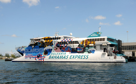 bahama: Miami, USA - September 11, 2011: Fast ferry boat connecting Miami with the island of Grand Bahama. The Bahamas are very dependant on US tourism to the islands