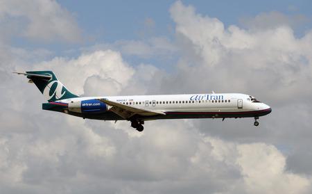 tran: Miami, USA - September 17, 2011: Air Tran passenger jet landing at Miami International Airport. Air Tran is headquartered in Atlanta and provides low cost flights throughout the US