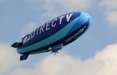 sponsorship: Miami, USA - January 16, 2011: Modern airship flying promotional tour over Miami, Florida with DirecTV sponsorship