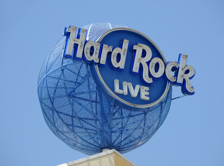hard rock: Fort Lauderdale, USA - September 7, 2008: newly opened Seminole Hard Rock Hotel and Casino attracts visitirs with large outdoor signs. It is built on the grounds of the Seminole tribe of Indians near Fort Lauderdale, Florida