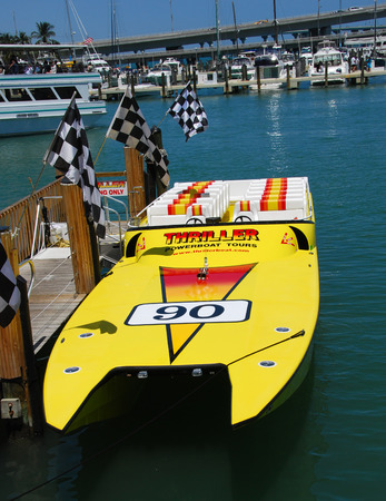 thrill: Maimi, USA - April 7, 2007: Yellow speedboat offering thrill rides to tourists. Miamis beaches and waterways are a popular tourist attraction