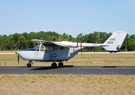 cessna: Titusville, USA - March 17, 2007: Vietnam War era Cessna O-2A Skymaster taxiing for takeoff. The Skymaster was used for reconnaisance missions during the Vietnam War. Some airplanes remain flying in private ownership